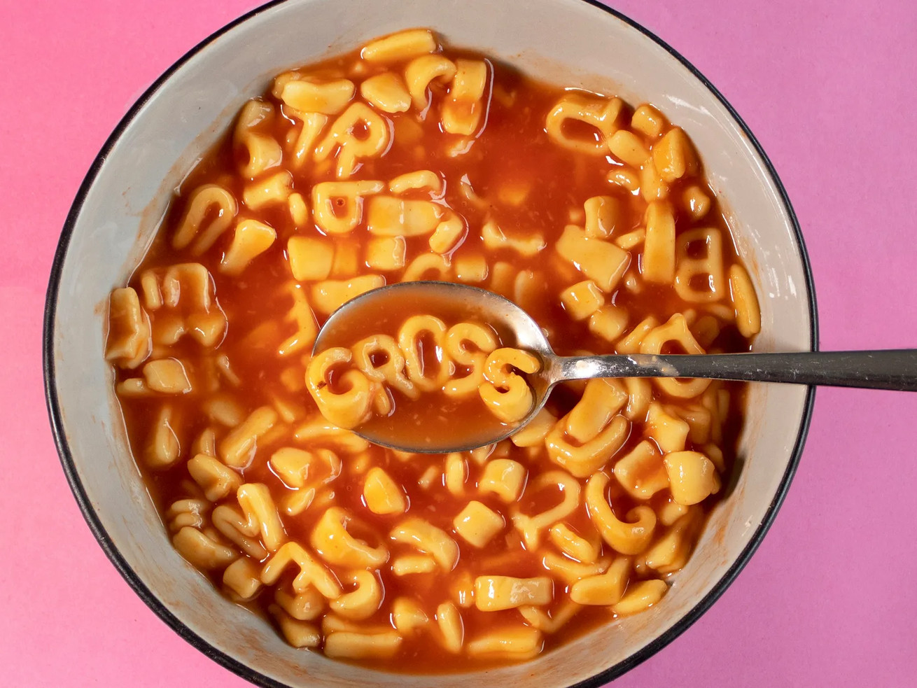 "Alphabet pasta spelling out ""Gross"""