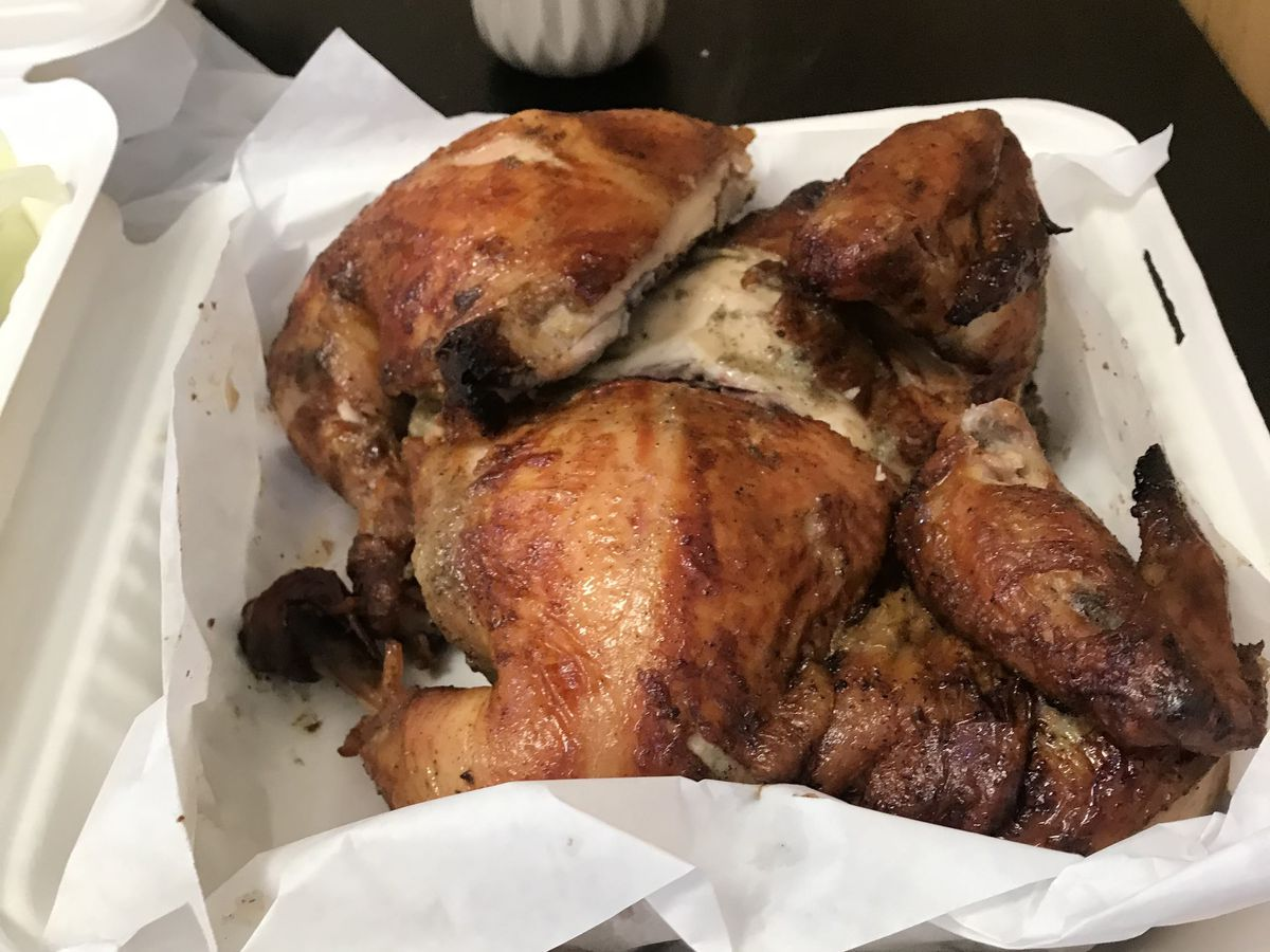 Peruvian rotisserie chicken in a takeout container
