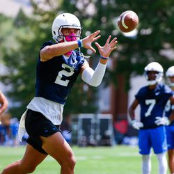 BYU wide receiver Neil Pau'u catches a pass while wearing a mask during the Cougars' opening day of training camp on Tuesday, Aug. 4, 2020, in Provo.