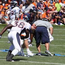 Peyton Manning about to hand off to rookie RB Montee Ball