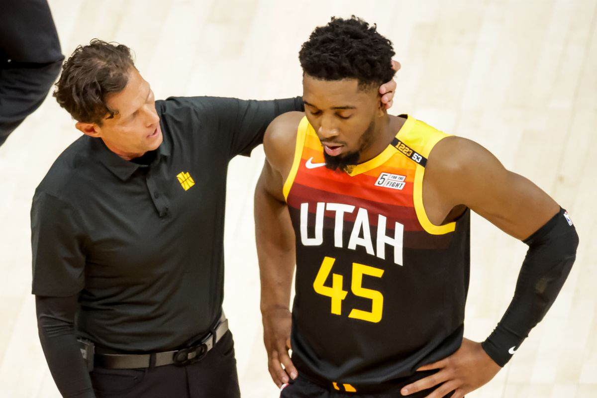 Utah Jazz head coach Quin Snyder puts his hand on the back of the head of Utah Jazz guard Donovan Mitchell.