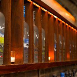 GREY GOOSE behind the bar.