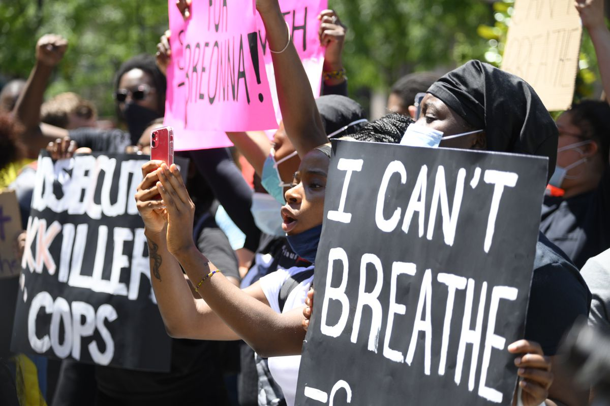 "Protesters in Philadelphia hold signs, including one saying ""I Can't Breathe"""