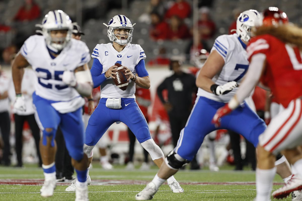 Zach Wilson of the BYU Cougars looks to pass against the Houston Cougars in the second half at TDECU Stadium on October 16, 2020 in Houston, Texas.
