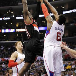 Portland Trail Blazers forward J.J. Hickson, center, dunks over Los Angeles Clippers center DeAndre Jordan as forward Blake Griffin watches during the first half of their NBA basketball game, Friday, March 30, 2012, in Los Angeles.  (AP Photo/Mark J. Terrill)