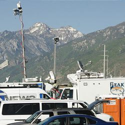 News media vehicles crowd the parking lot of the Fred House Training Center near the Utah State Prison prior to the execution.