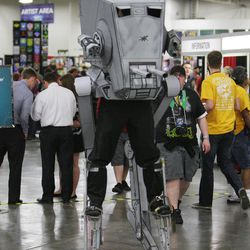 Rauben Creed walks around as an Imperial Walker at Comic Con at the Salt Palace in Salt Lake City Thursday, April 17, 2014.