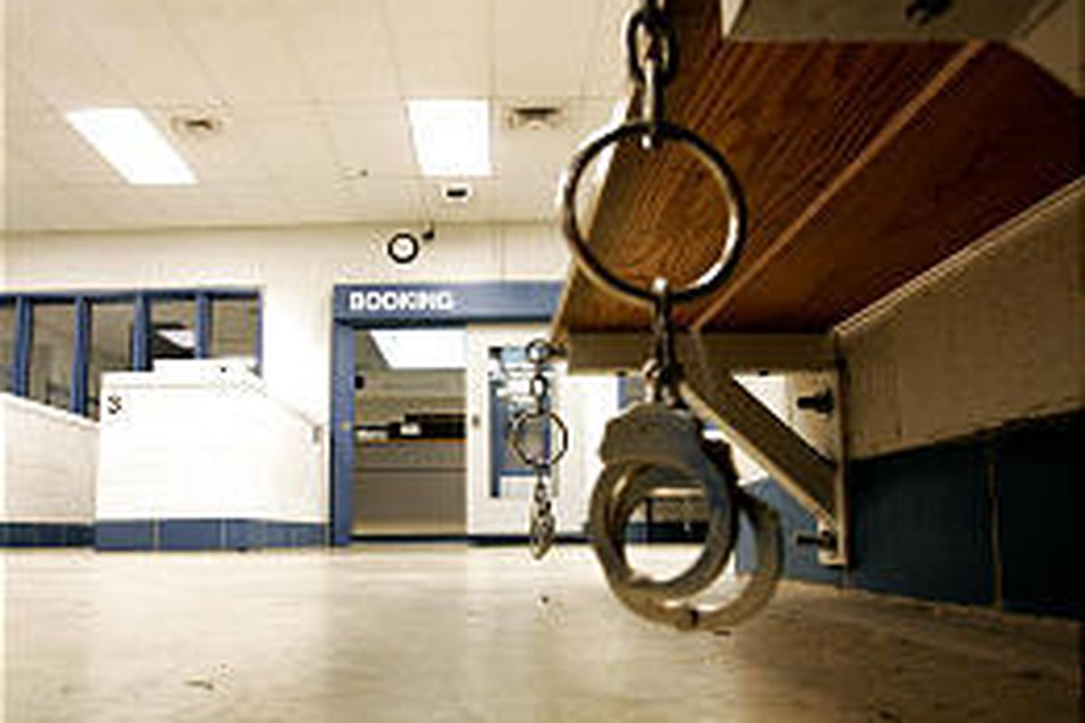 Handcuffs hang from a bench in the pre-booking area of the Utah County Jail, where suicides are increasing.