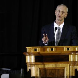 Former BYU quarterback Robbie Bosco speaks at a public memorial service for former Cougar football coach LaVell Edwards at the Provo Convention Center on Friday, Jan. 6, 2017.