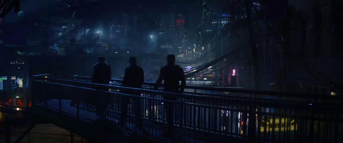 Sam Wilson and Bucky Barnes walk through a dingy neon-lit city in Falcon and the Winter Soldier.