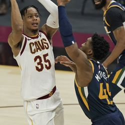 Cleveland Cavaliers' Isaac Okoro (35) shoots over Utah Jazz's Donovan Mitchell (45) in the second half of an NBA basketball game, Tuesday, Jan. 12, 2021, in Cleveland.