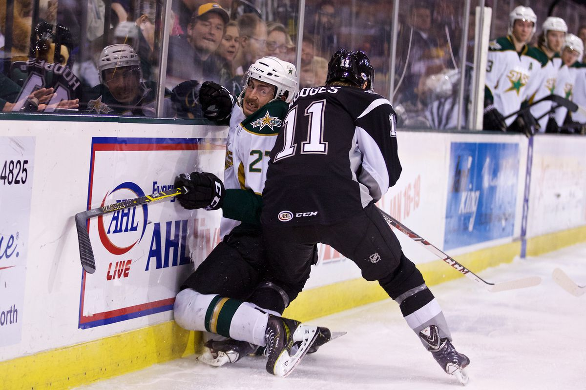 Greg Rallo is crushed along the boards by a San Antonio skater.