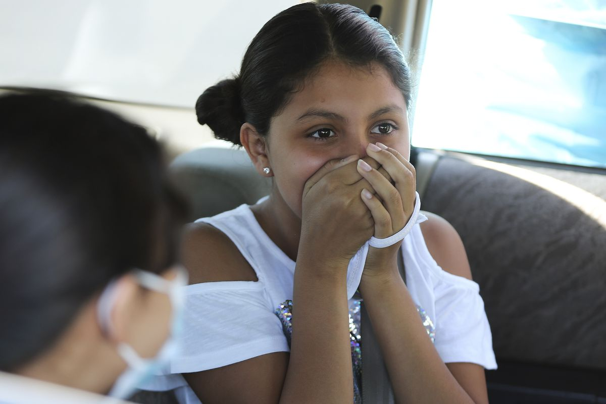 April Medina holds her nose after being tested for COVID-19 in West Valley City on Wednesday, July 15, 2020.