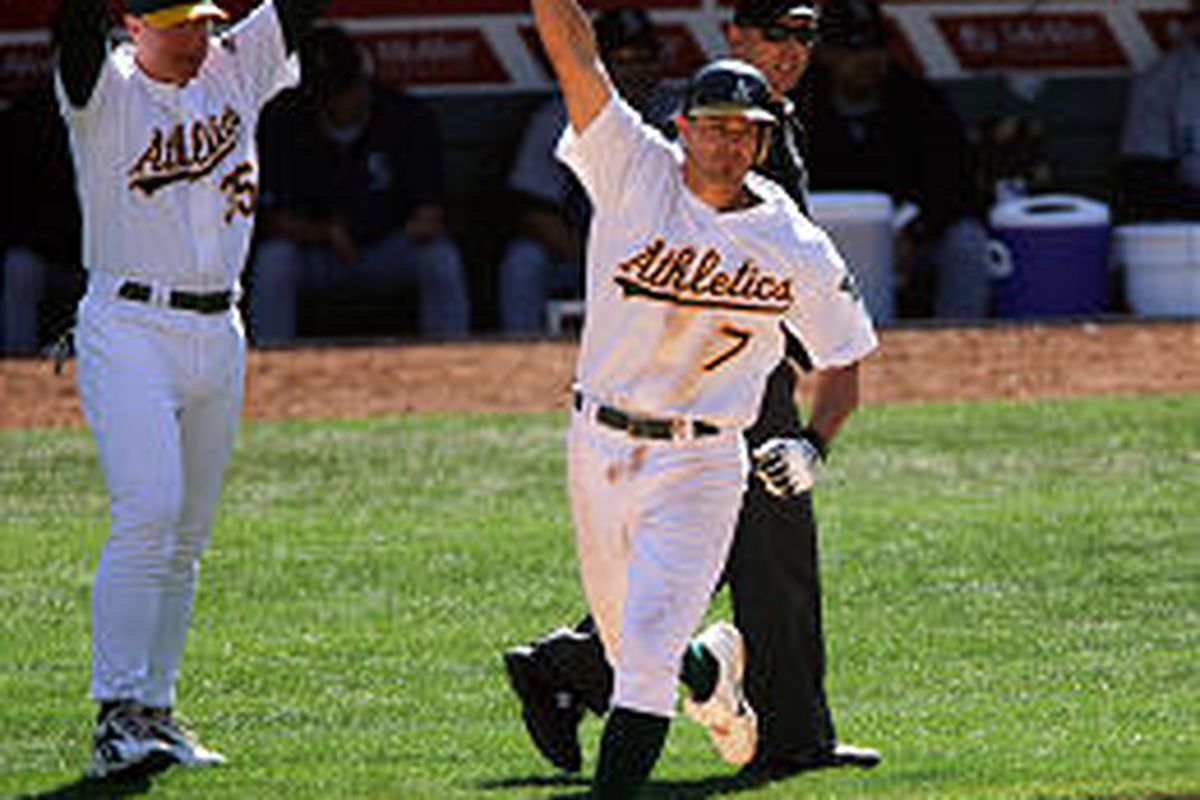 Oakland's Bobby Crosby celebrates after hitting a walk off solo home run in the ninth inning Thursday.