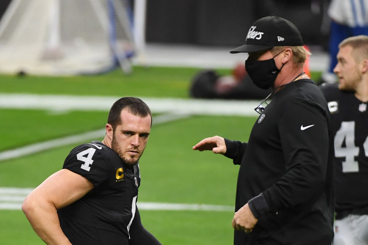 Head coach Jon Gruden of the Las Vegas Raiders talks with quarterback Derek Carr #4 during warmups before their game against the Indianapolis Colts at Allegiant Stadium on December 13, 2020 in Las Vegas, Nevada.