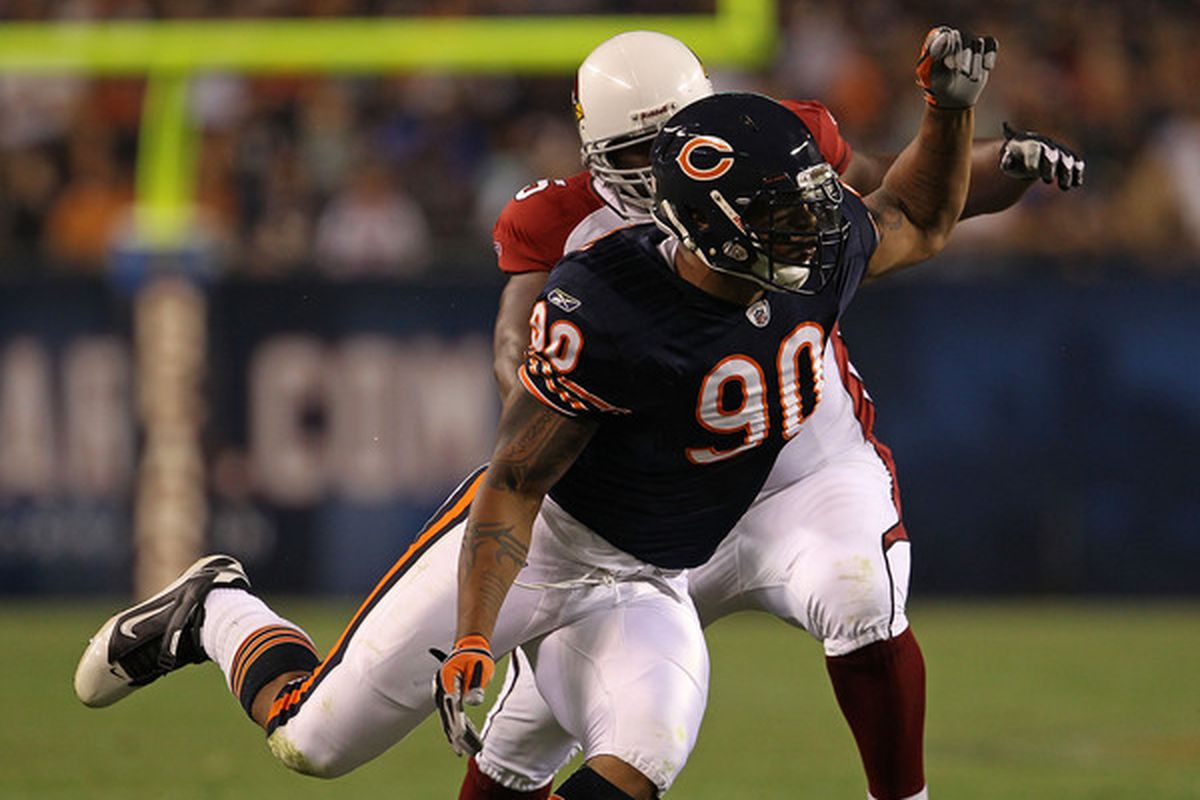 CHICAGO - AUGUST 28: Julius Peppers #90 of the Chicago Bears rushes past Levi Brown #75 of the Arizona Cardinals during a preseason game at Soldier Field on August 28 2010 in Chicago Illinois. (Photo by Jonathan Daniel/Getty Images)