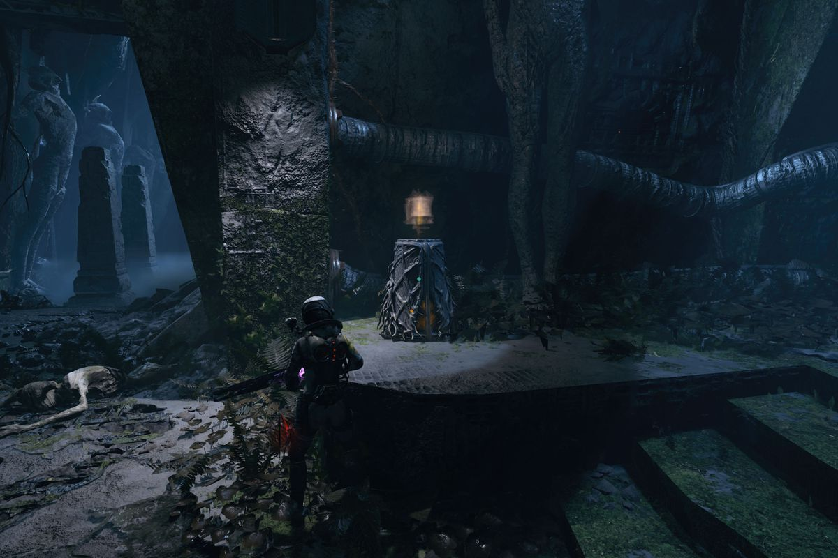 The main character of Returnal stands near an Obolite Repository