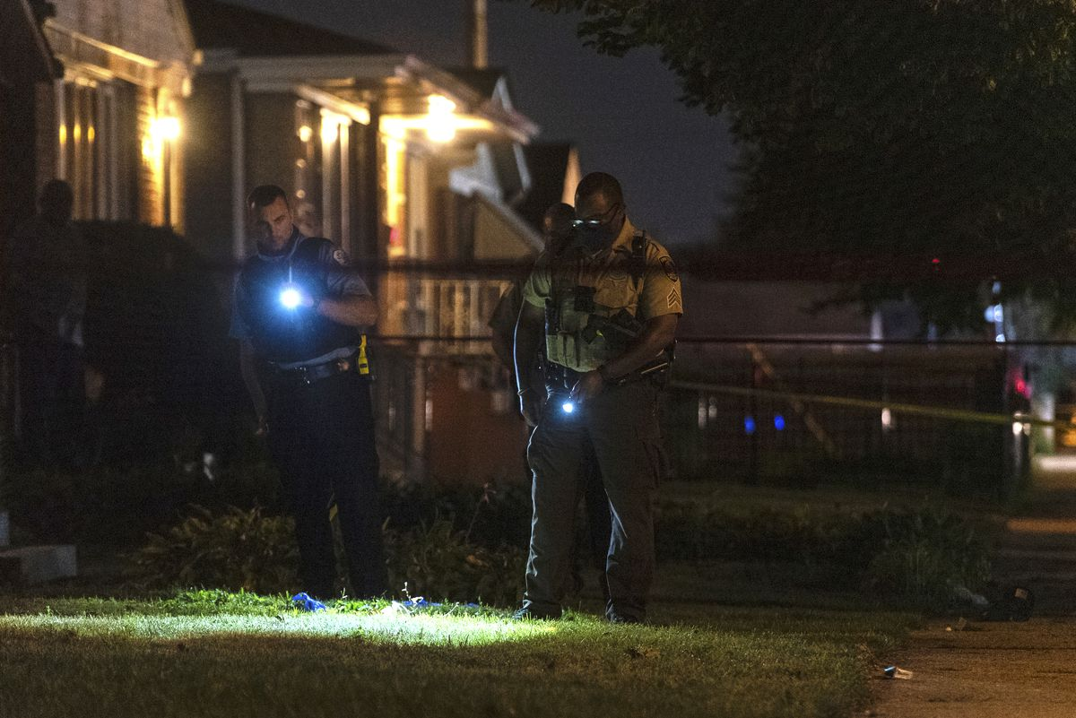Chicago police and Cook County Sheriff's officers investigate the scene where a Cook County Sheriff's officer shot a person in the 4600 block of South Laramie in the LeClaire Courts neighborhood, Wednesday, Sept. 2, 2020.