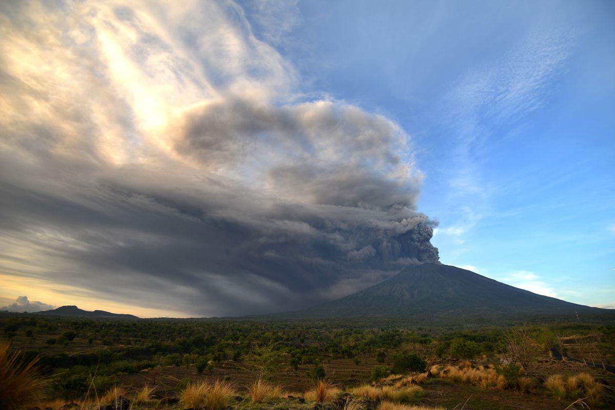 General view of Mount Agung during an eruption seen from Kubu sub-district in Karangasem Regency, on Indonesia's resort island of Bali on November 26, 2017.