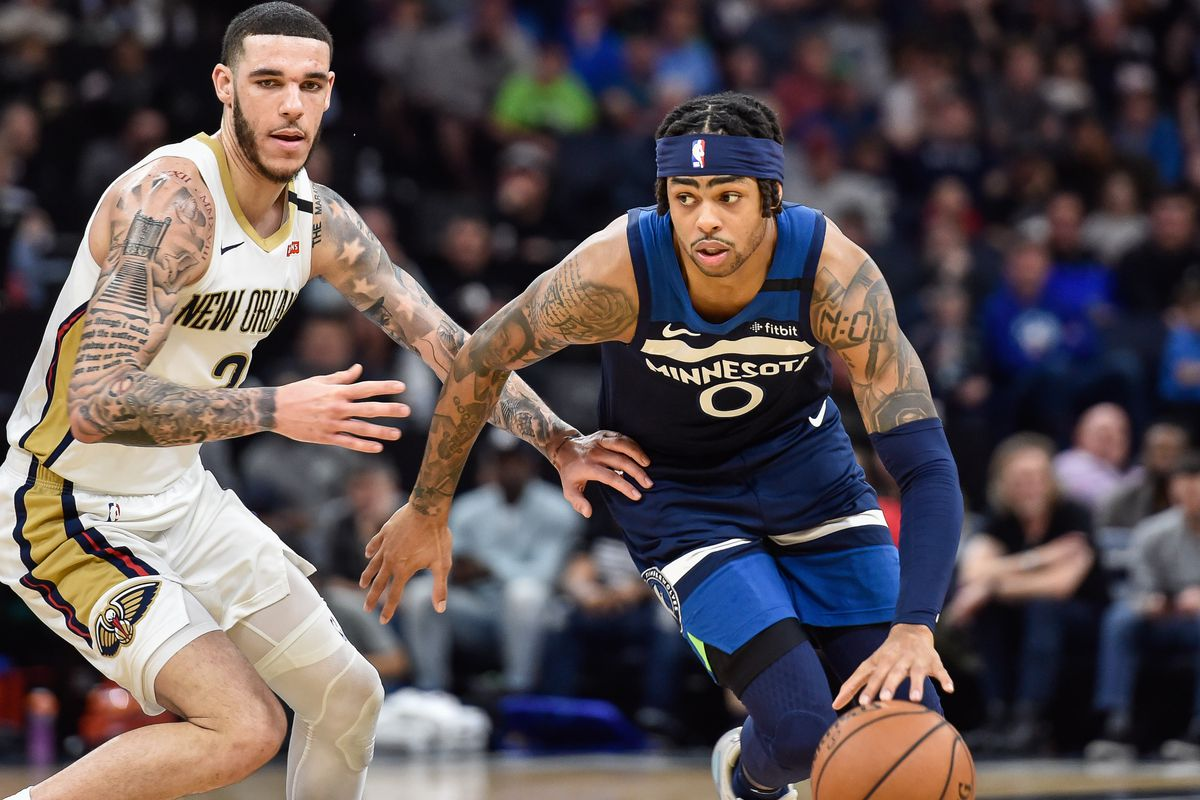 Minnesota Timberwolves guard D'Angelo Russell controls the ball as New Orleans Pelicans guard Lonzo Ball looks on during the second half at Target Center.