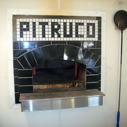 The entry of the wood-fired oven on the truck.