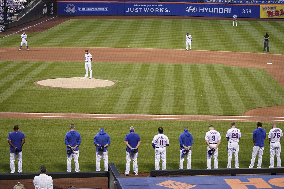 New York Mets and Miami Marlins players took their positions, then reserves and coaches filed out of both dugouts and stood silently for 42 seconds. Both teams then left the field.