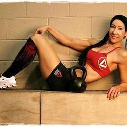 """<a href=""""http://vegas.racked.com/archives/2014/08/11/hottest-trainer-contestant-1-lisa-balash.php"""">Lisa Balash, also known at the Kettlebell Bombshell</a>"""