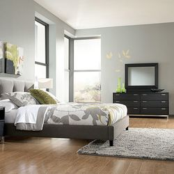 """<a href=""""http://www.furniturepenncampus.com/category/bedrooms/masterton-queen-upholsteredbed-dresser-mirror.html"""">Masterson Queen Upholstered Bed</a>, $399.99, also from Furniture Lifestyle"""