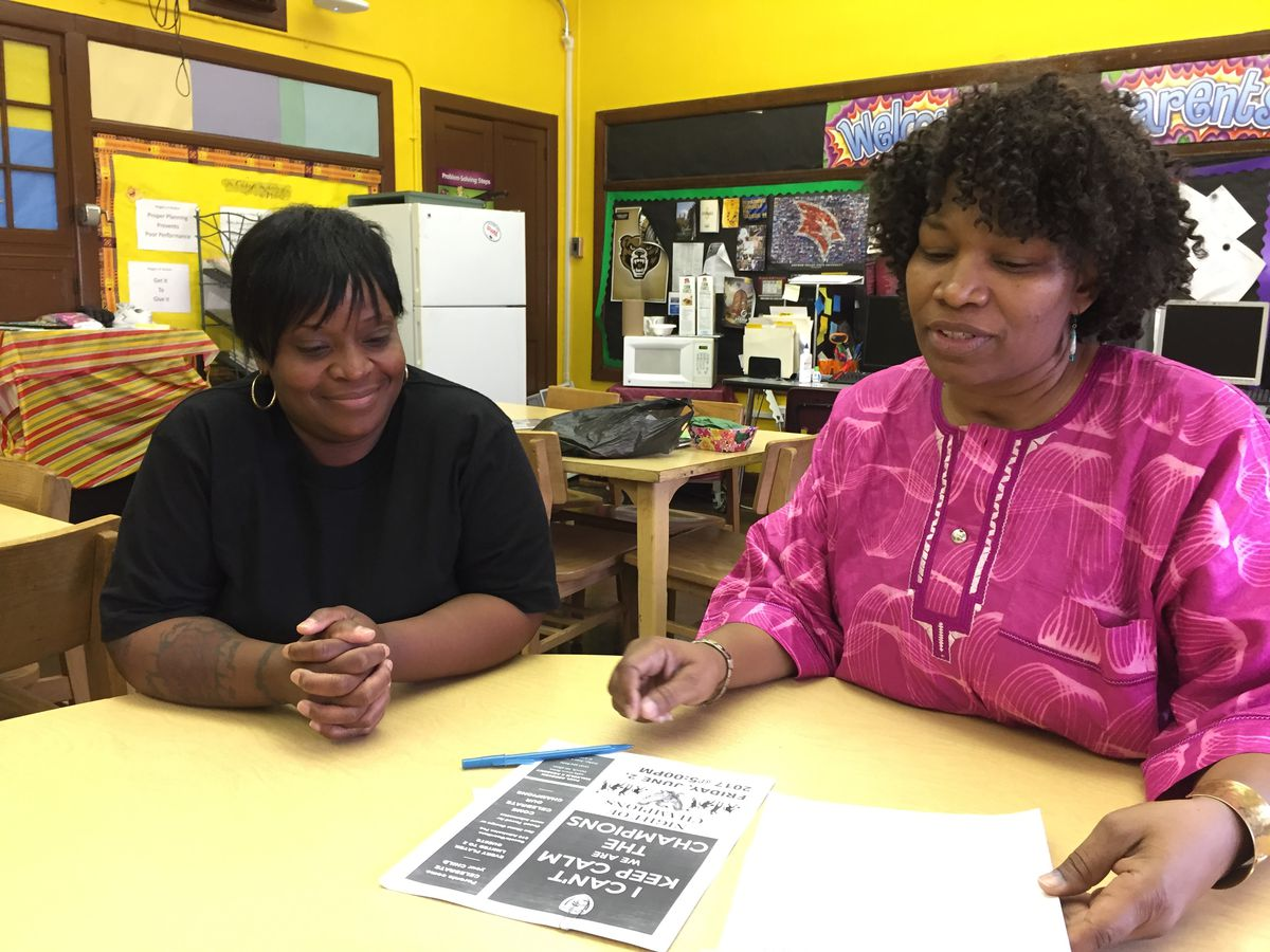 Parent leaders Aliya Moore, left, and Stephanie Beal have organized protests at the Paul Robeson Malcolm X Academy to protest a teacher shortage that has left kids without needed instruction.