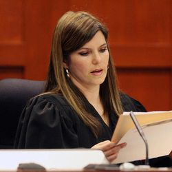 Circuit Judge Jessica Recksiedler holds a status hearing Friday, April 13, 2012, in Sanford, Fla., in the second-degree murder case against neighborhood watch volunteer George Zimmerman. Attorneys are asking for a bond hearing next Friday and for the judge to remove herself from the case because her husband is a member of a law firm whose founder is a legal analyst on television. Zimmerman has been charged in the shooting death of Trayvon Martin on Feb. 26, in Sanford.