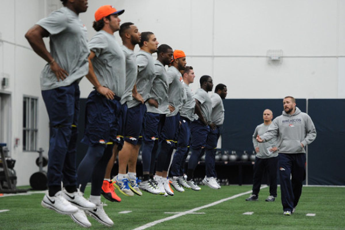 Broncos jump on the first day of 2014 voluntary workouts.