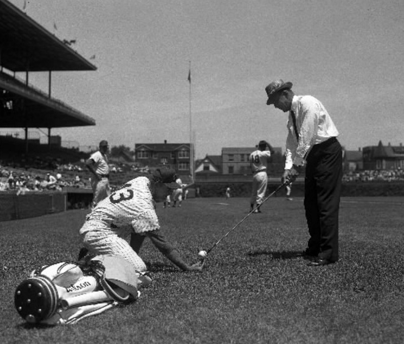 Golfer Sam Snead takes aim in Wrigley Field with the help of Cubs pitcher Don Cardwell on July 6, 1961. Ten years earlier, Snead struck the Cubs scoreboard with a lazy 4-iron from home plate and then cleared the scoreboard with a 2-iron.   Sun-Times Media
