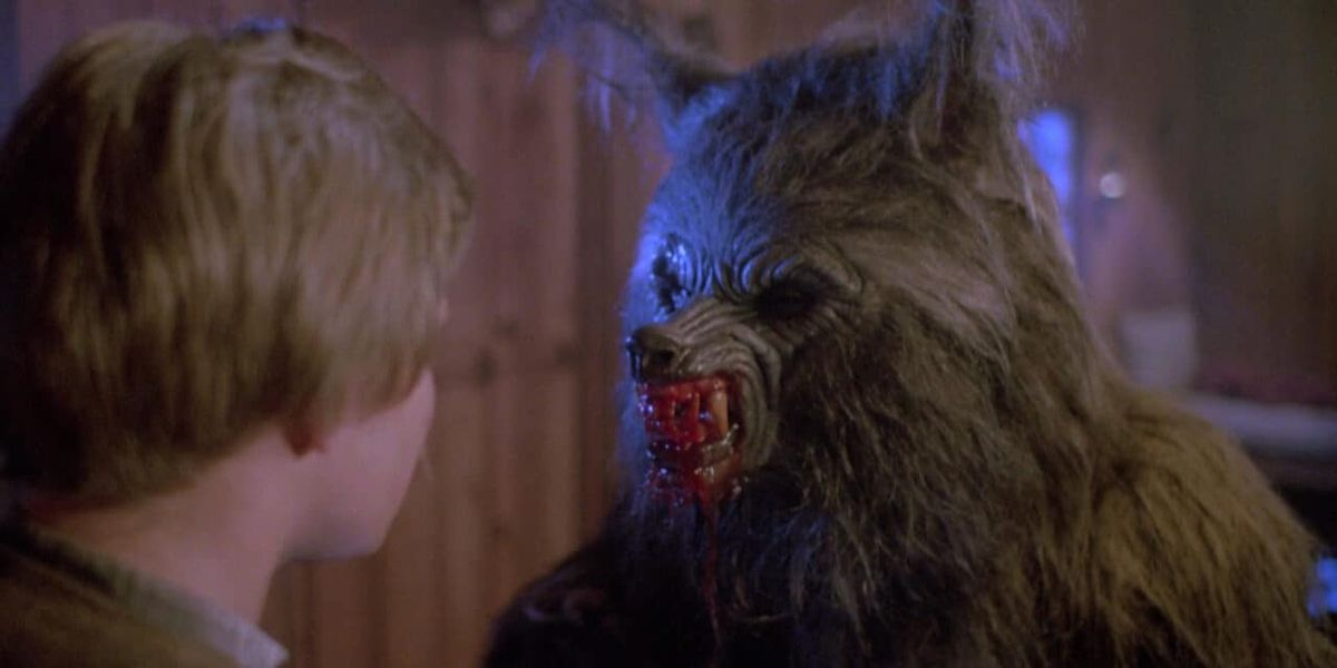 A werewolf bares his bloodied fangs at a young boy in Waxwork (1998)