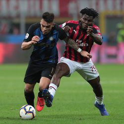 Lautaro Martinez (L) of FC Internazionale is challenged by Frank Kessie of AC Milan during the Serie A match between AC Milan and FC Internazionale at Stadio Giuseppe Meazza on March 17, 2019 in Milan, Italy.