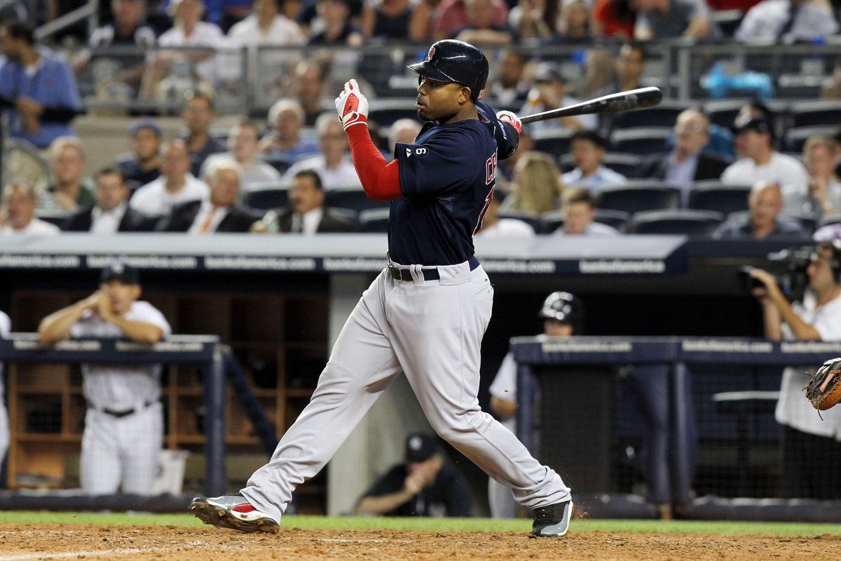 Bronx, NY, USA; Boston Red Sox left fielder Carl Crawford (13) hits a double during the eighth inning of a game against the New York Yankees at Yankee Stadium. Mandatory Credit: Brad Penner-US PRESSWIRE