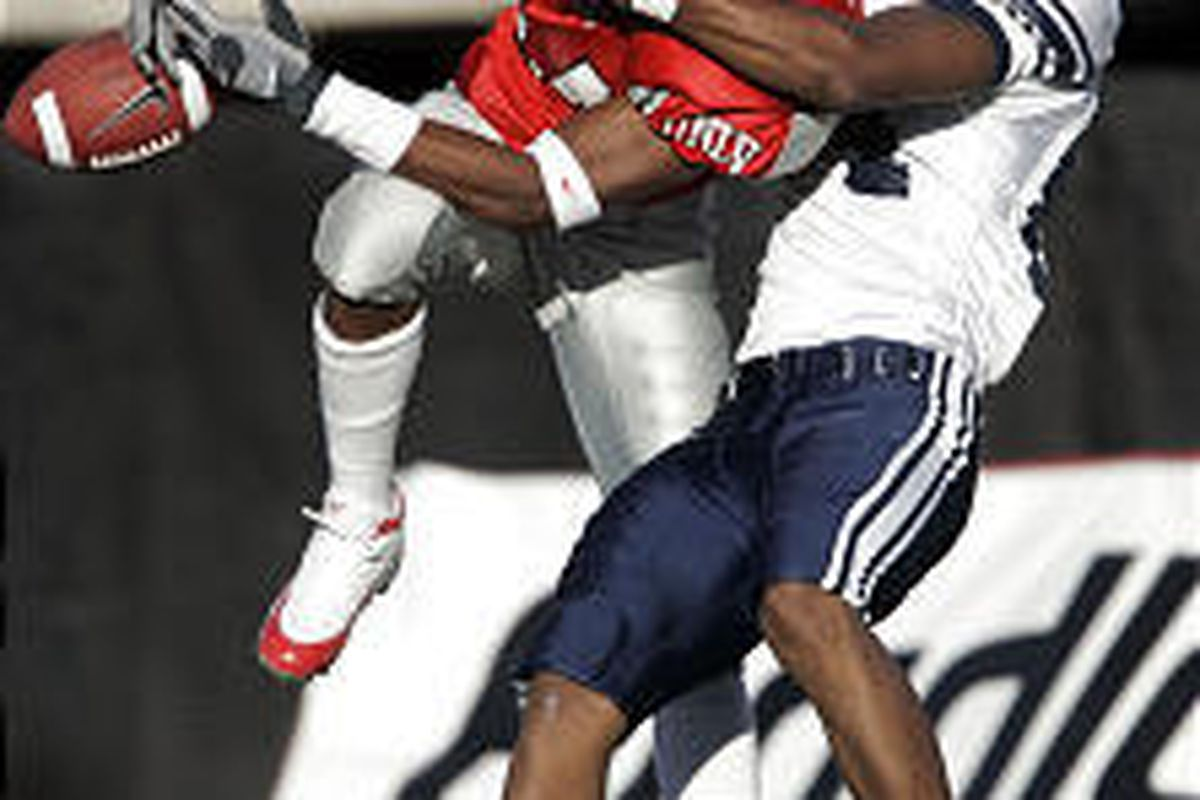 UNLV's Ernest Gordon, left, breaks up a pass intended for BYU wide receiver Michael Reed in the fourth quarter of Saturday's game.