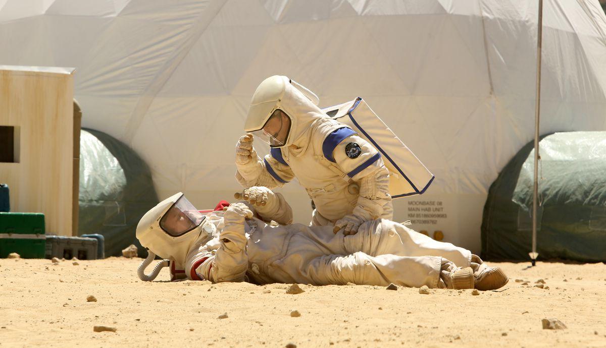 John C. Reilly and Tim Heidecker in spacesuits in Moonbase 8