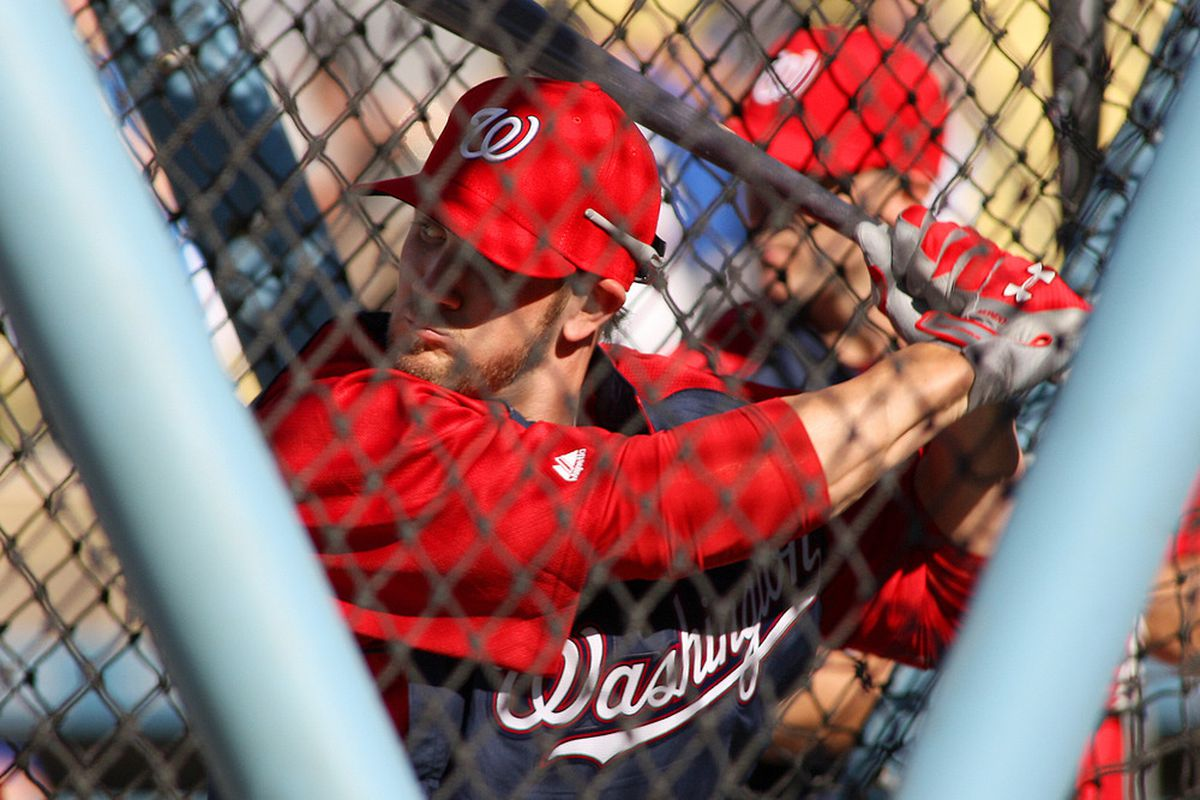 Apr 28, 2012; Los Angeles, CA, USA; Washington Nationals right fielder Bryce Harper (34) takes batting practice before a game against the Los Angeles Dodgers at Dodger Stadium.  Mandatory Credit: Jake Roth-US PRESSWIRE