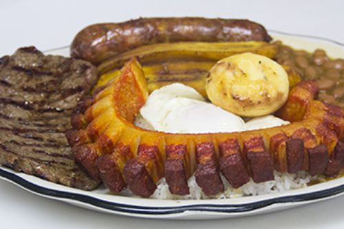 A large plate of various meats and starches from El Peñol, a Colombian restaurant in East Boston