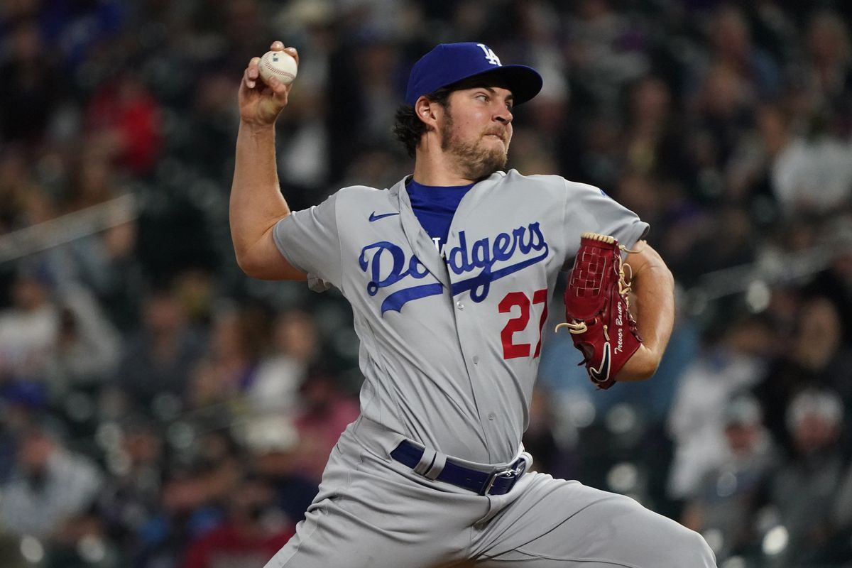 Los Angeles Dodgers starting pitcher Trevor Bauer delivers a pitch in fifth inning against the Colorado Rockies at Coors Field.