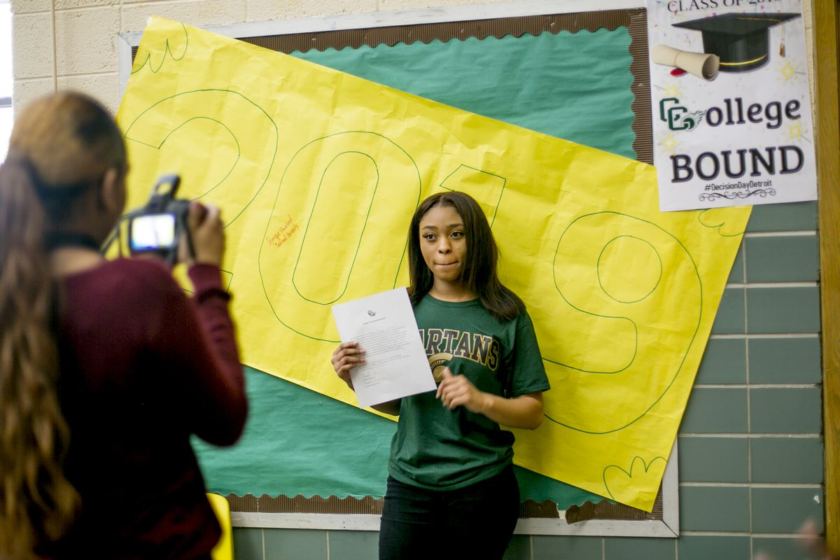 Marqell McClendon, 17, a senior at Cody High School in Detroit, holds up her letter of intent to attend Michigan State University.