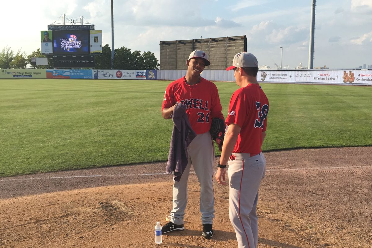 Jose Almonte speaks to the bullpen coach prior to his start against the Staten Island Yankees