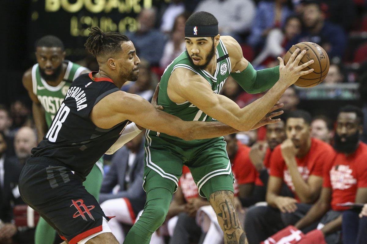 Boston Celtics forward Jayson Tatum controls the ball as Houston Rockets forward Thabo Sefolosha defends during the second quarter at Toyota Center.