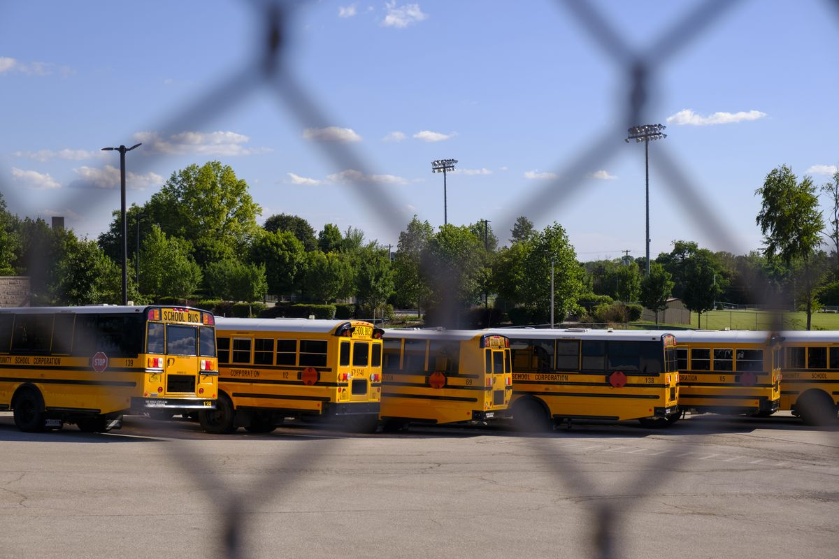 School buses fill an MCCSC parking area for buses in Bloomington, Indiana.