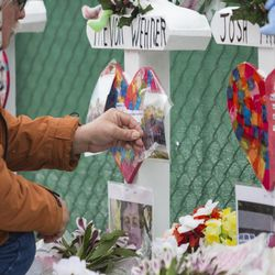 Mourners pay their respects at a memorial for the five people killed two days earlier in a mass shooting at the Henry Pratt Company in Aurora, Sunday afternoon, Feb. 17, 2019.   Ashlee Rezin/Sun-Times
