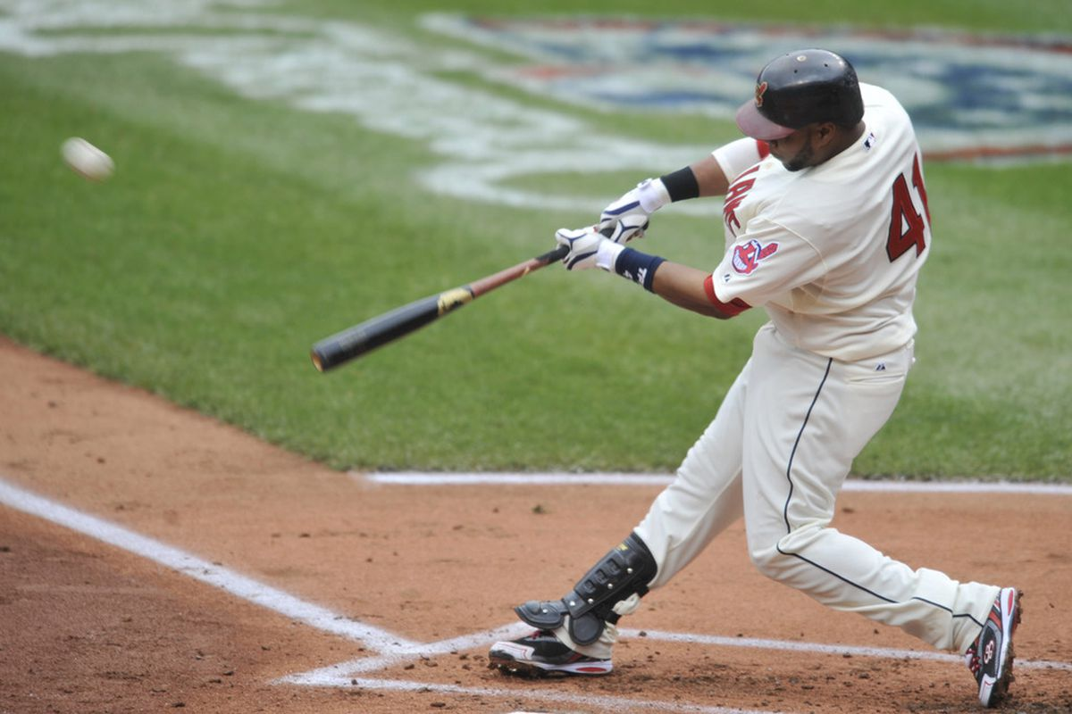 Apr 8, 2012; Cleveland, OH, USA; Cleveland Indians catcher Carlos Santana (41) hits a solo home run in the second inning against the Toronto Blue Jays at Progressive Field. Mandatory Credit: David Richard-US PRESSWIRE