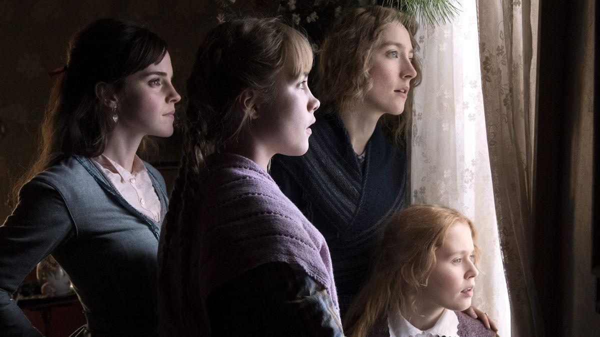 four young women gaze out of a window in Little Women
