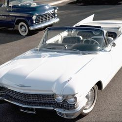 Both the 585XLTMXB and 1960 Cadillac Coup De Ville feature classic, signature designs that made a now-renowned brand famous.