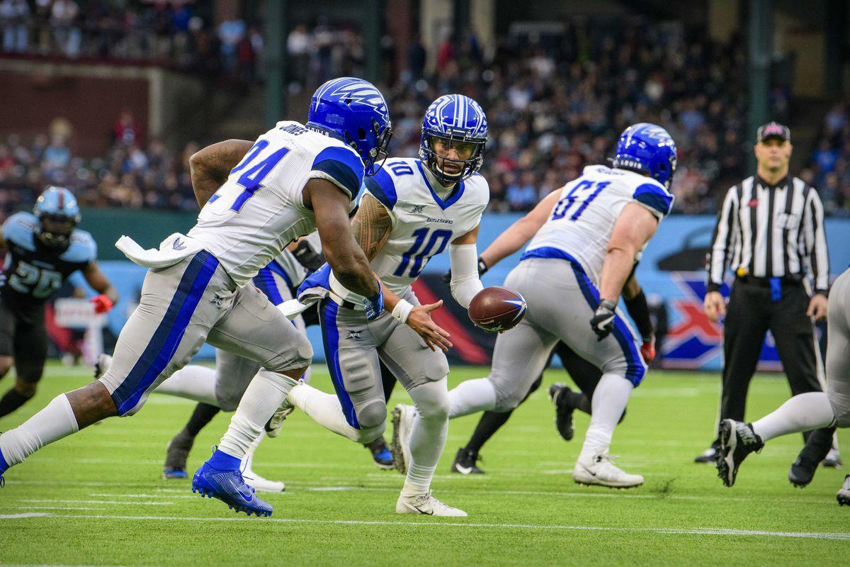 St. Louis Battlehawks quarterback Jordan Ta'amu hands off to running back Matt Jones during the first quarter against the Dallas Renegades in an XFL football game at Globe Life Park.