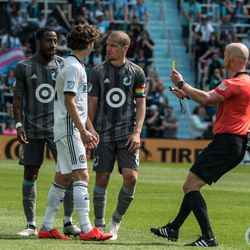 Ozzie Alonso and Brendon Aaronson share a moment during Minnesota United's 2-3 loss to the Philadelphia Union